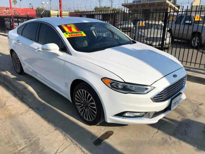 2017 WHITE Ford Fusion Titanium (3FA6P0K99HR) with an 2.0L L4 DOHC 16V engine, 6A transmission, located at 744 E Miner Ave, Stockton, CA, 95202, (209) 944-5770, 37.956863, -121.282082 - Photo #0